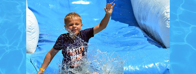 Beat the Heat with our Inflatable Water Slide Rentals!